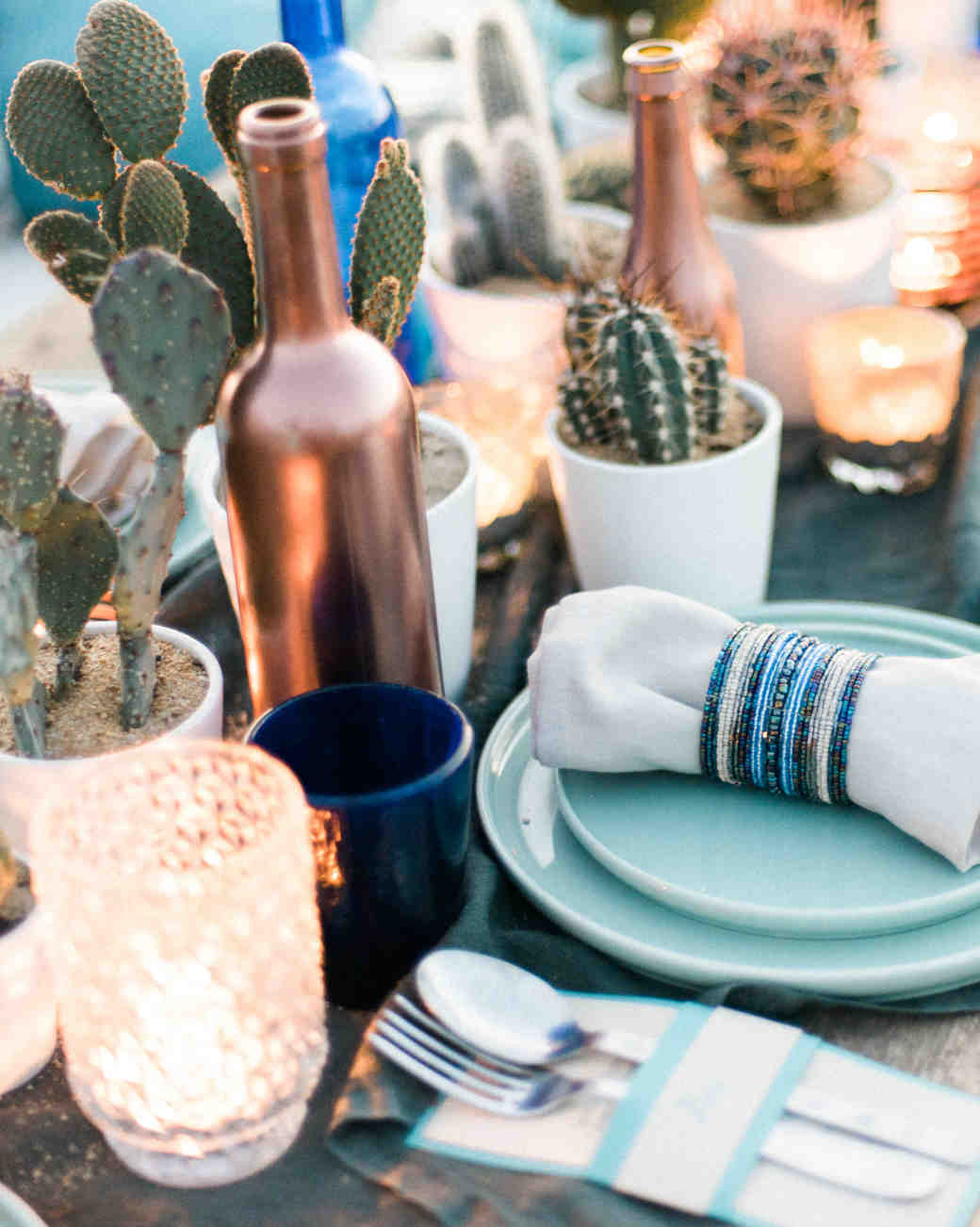 Cactus Centerpieces with Gold Sprayed Bottles