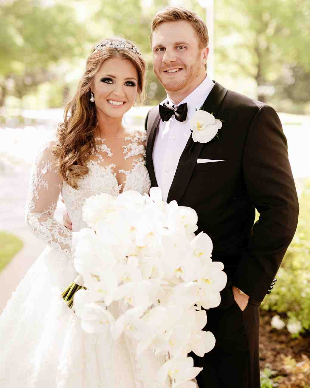 Glamorous all-white orchid wedding bouquet and black tie wedding