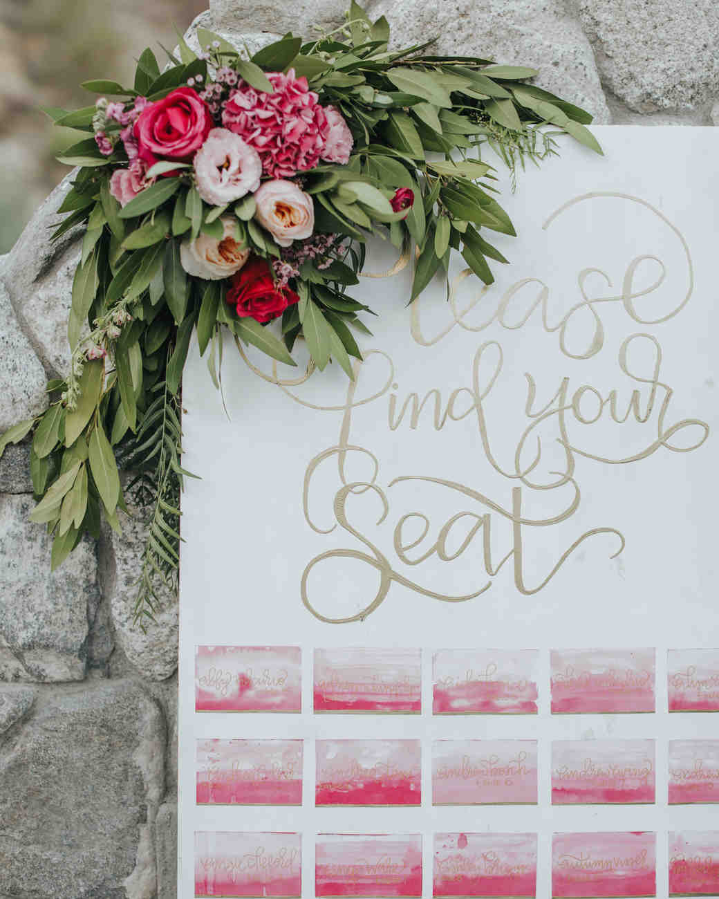 Pink watercolor seating chart with calligraphy