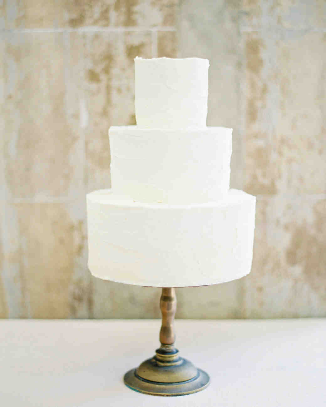 Three-Tiered White Wedding Cake with Deckle Edges