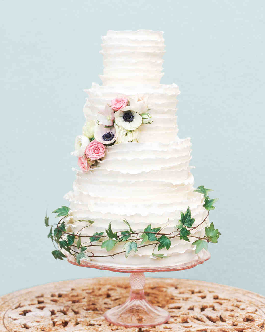 white ruffled cake with florals