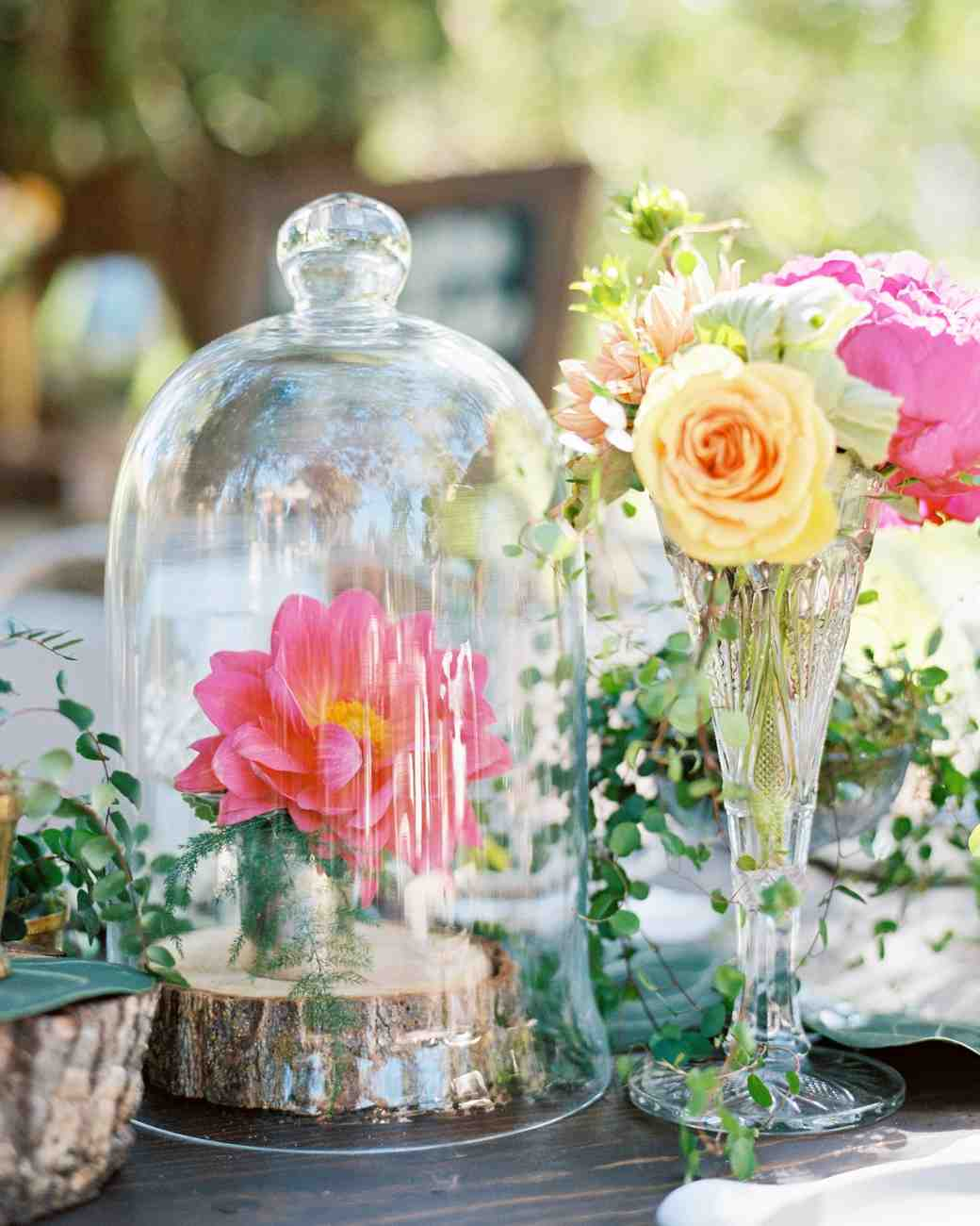 Pink rose wedding centerpiece with glass cloche and log slices
