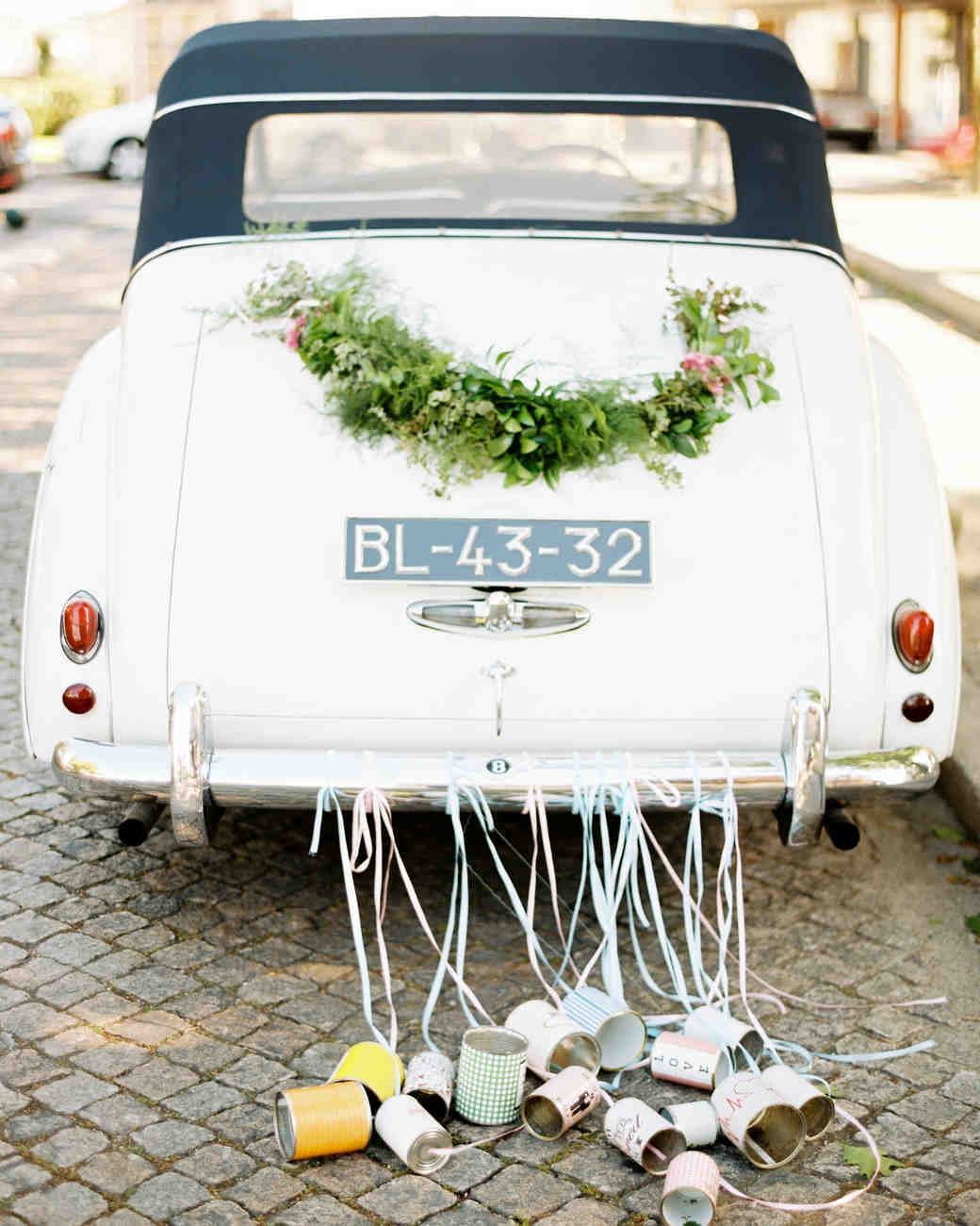 wedding getaway car with cans