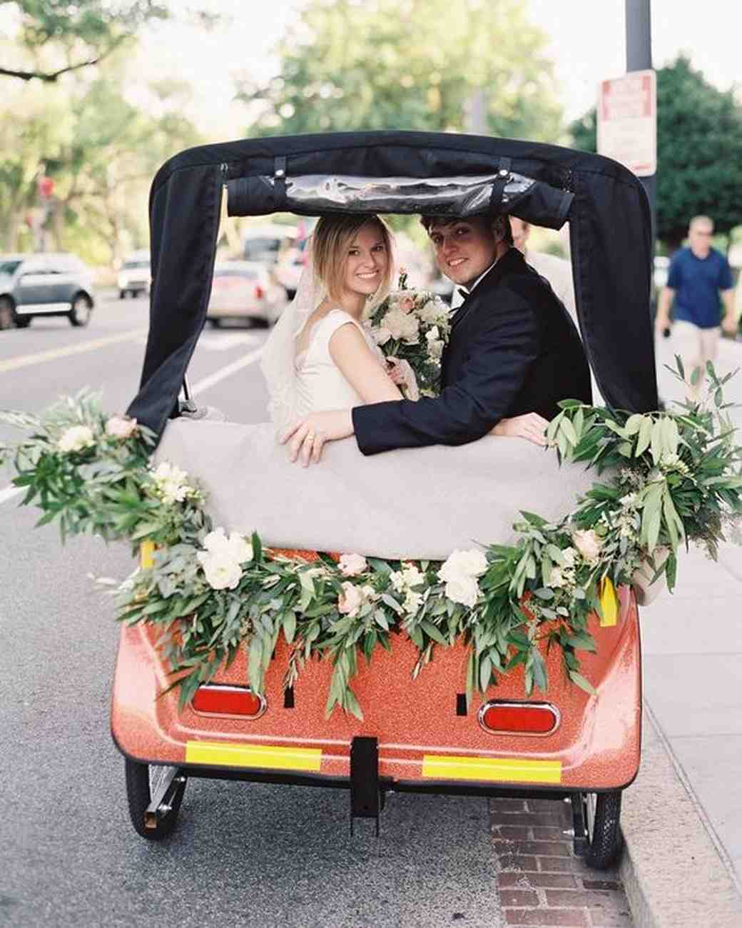 couple riding away from wedding