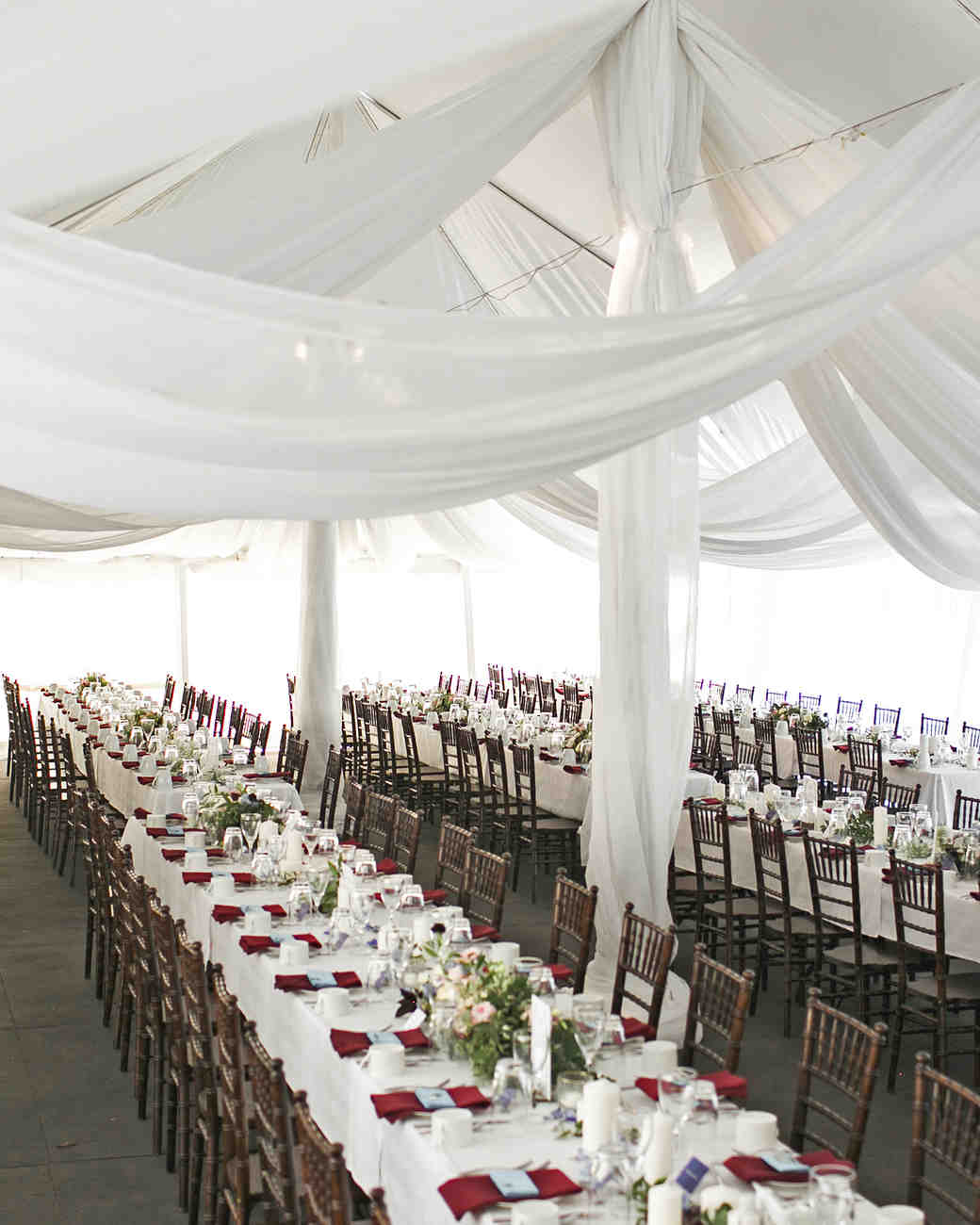 Long White Reception Tables with Red Napkins