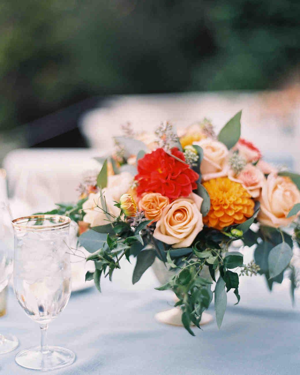Garden wedding centerpiece with roses and dahlias