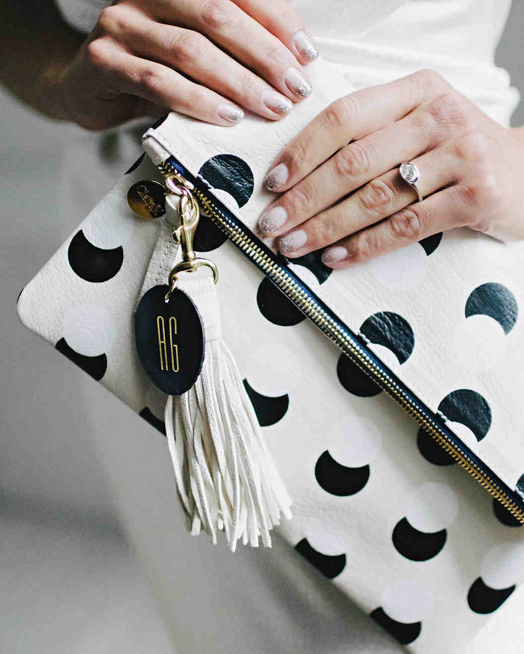 ana and damon black and white clutch