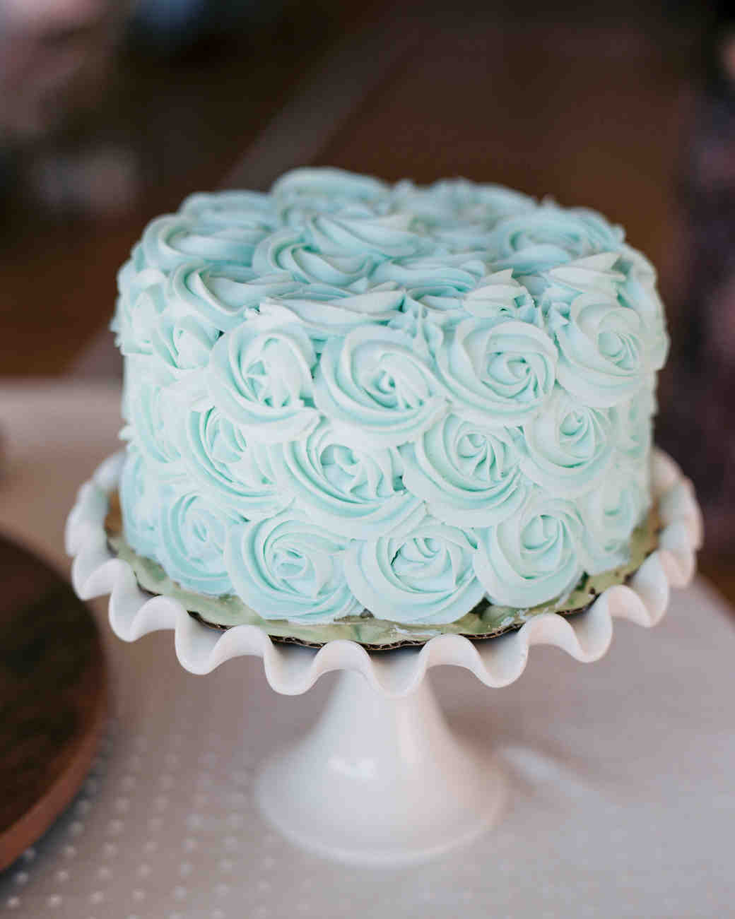 blue wedding cake with rose icing