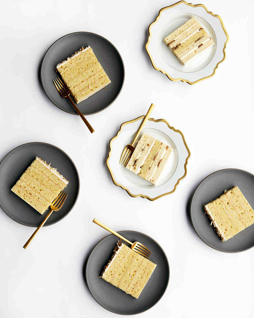 Wedding Cake and Gold-Rimmed Wedding Plates and Flatware