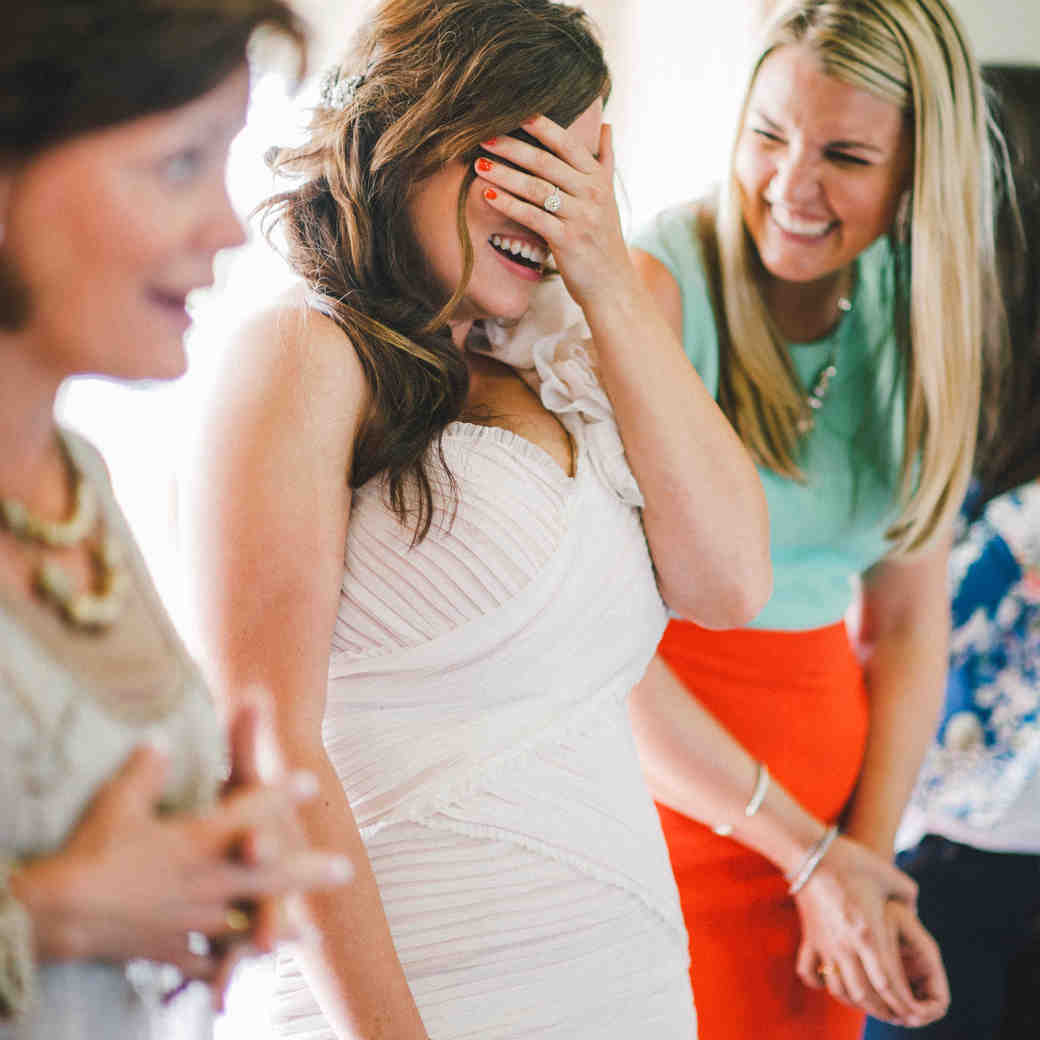 Bride Laughing and Covering Her Eyes