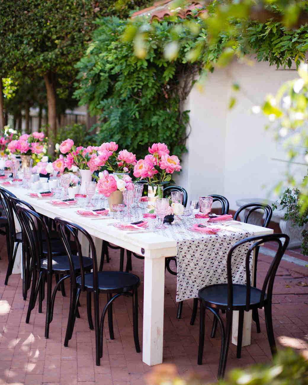 Pink, White, and Black Long Reception Table