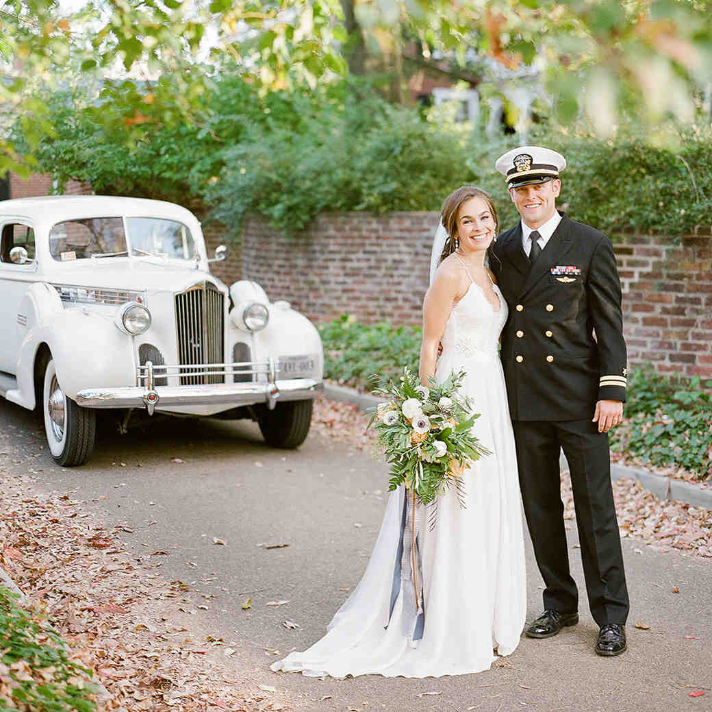 anne and staton wedding portrait with car