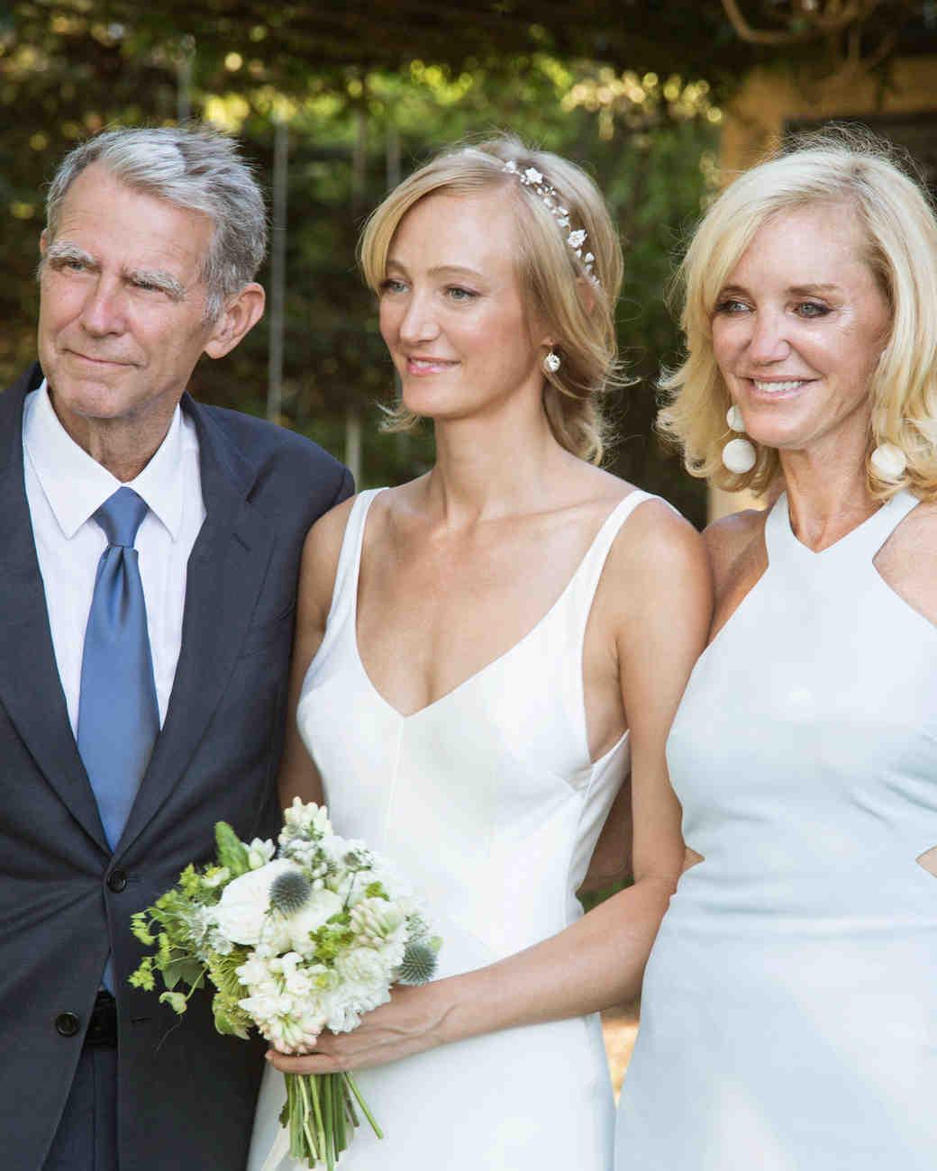 bride with parents outdoor portrait