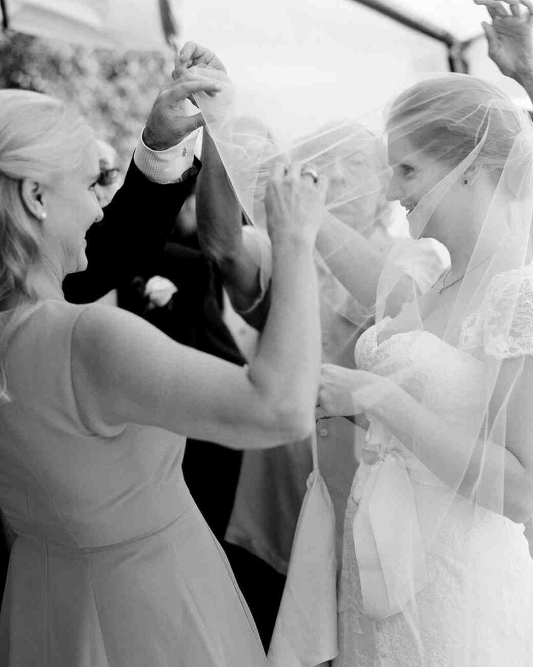 A Mother Helping Her Daughter with Her Wedding Veil