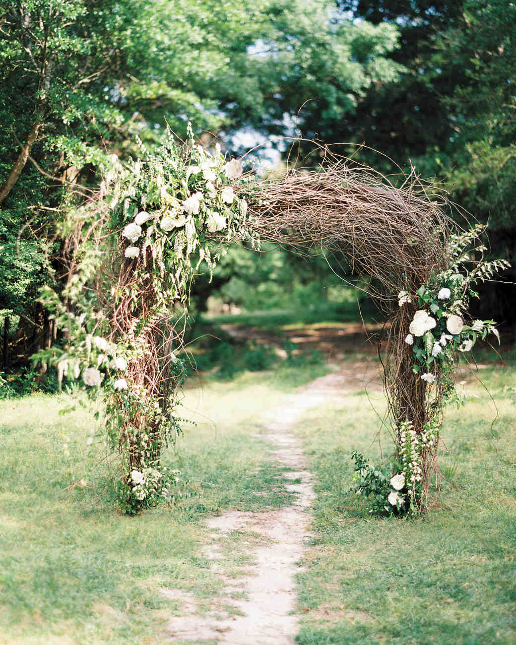 Wedding Arch with Vines and White Flowers
