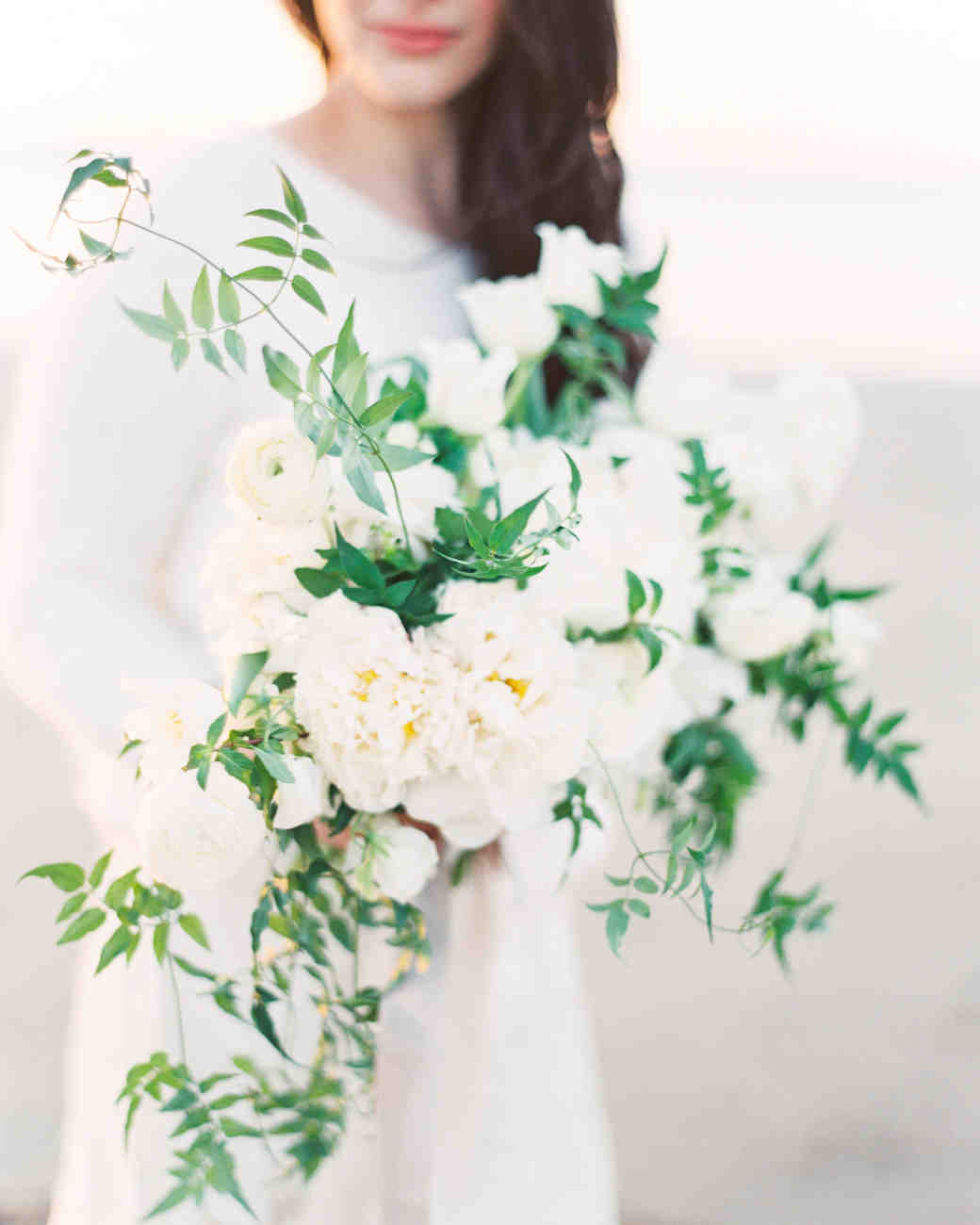 A Bride With an All-White Wedding Bouquet