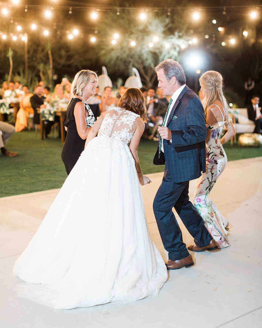 emily adhir wedding couple dancing with family
