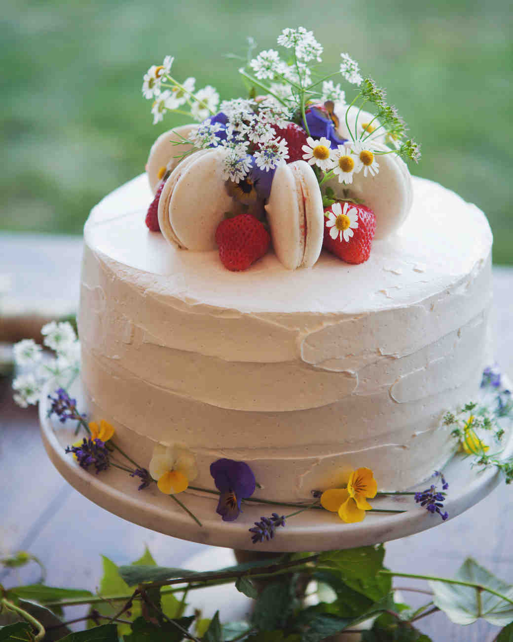 Small Wedding Cake with Flowers and Macarons