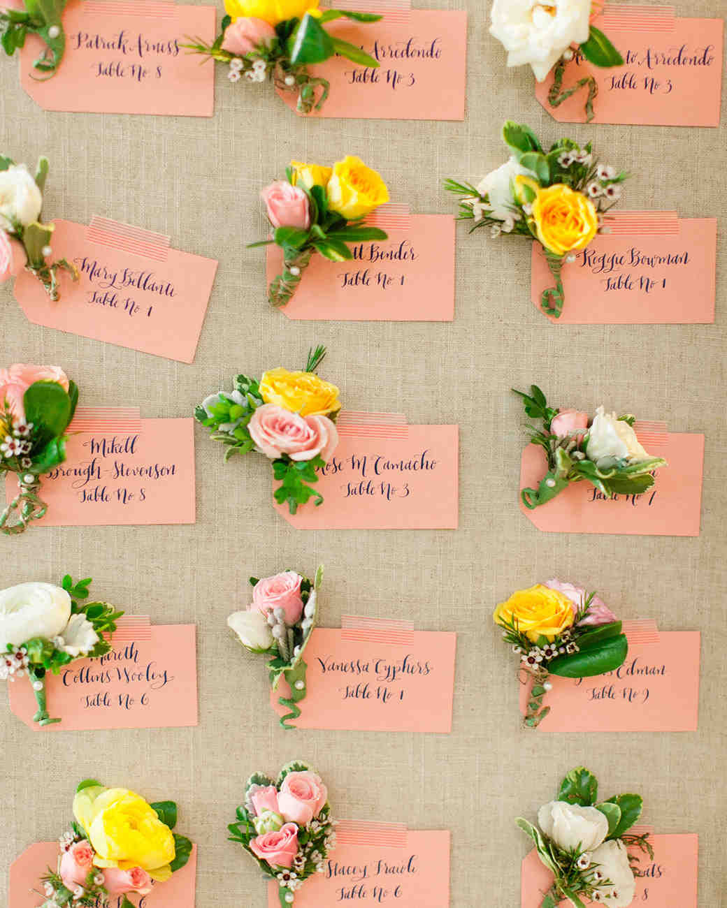 Colorful peach and burlap seating chart