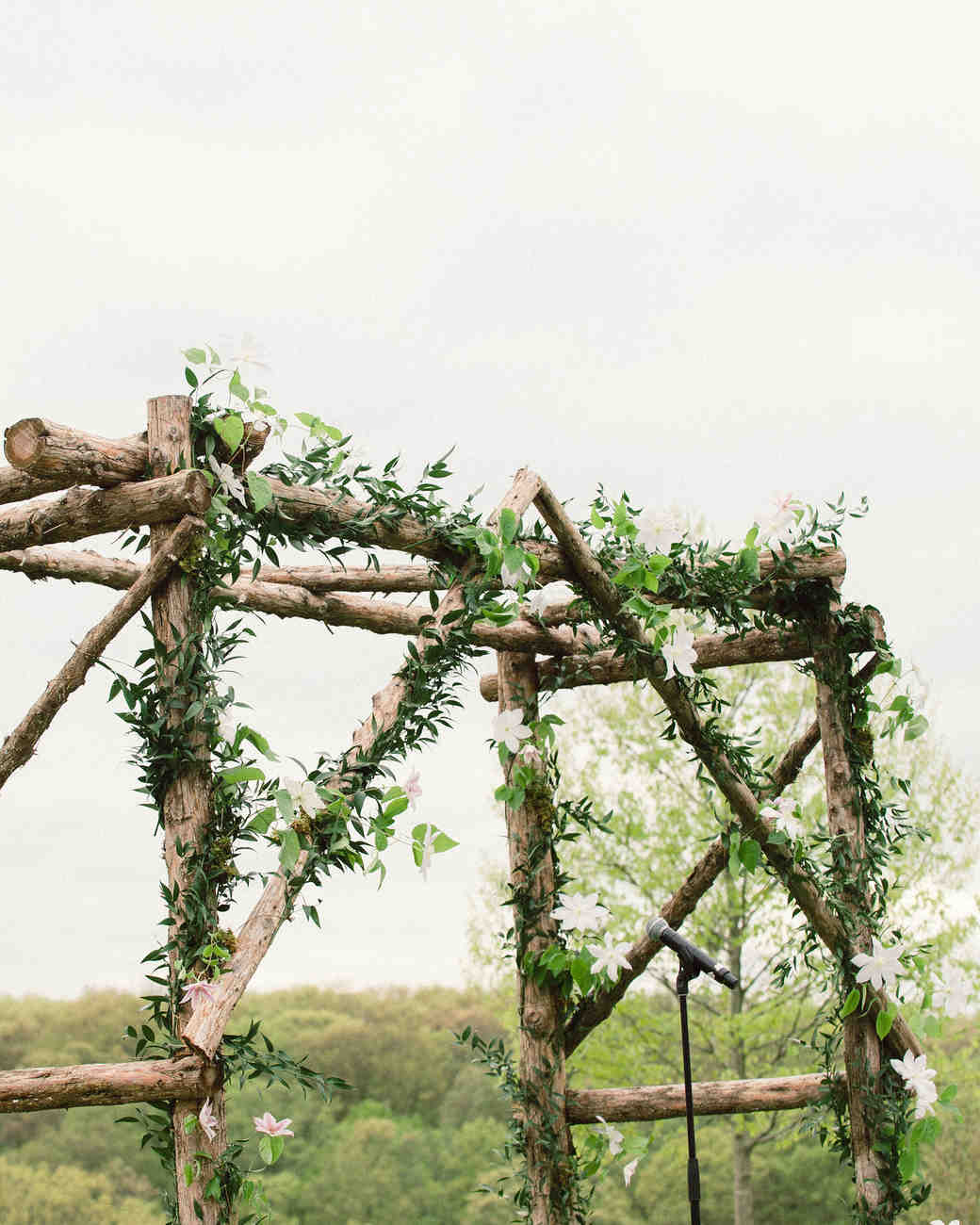 Green, White, and Wooden Wedding Arch