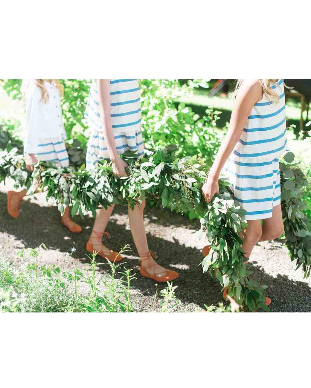 kids carrying garland