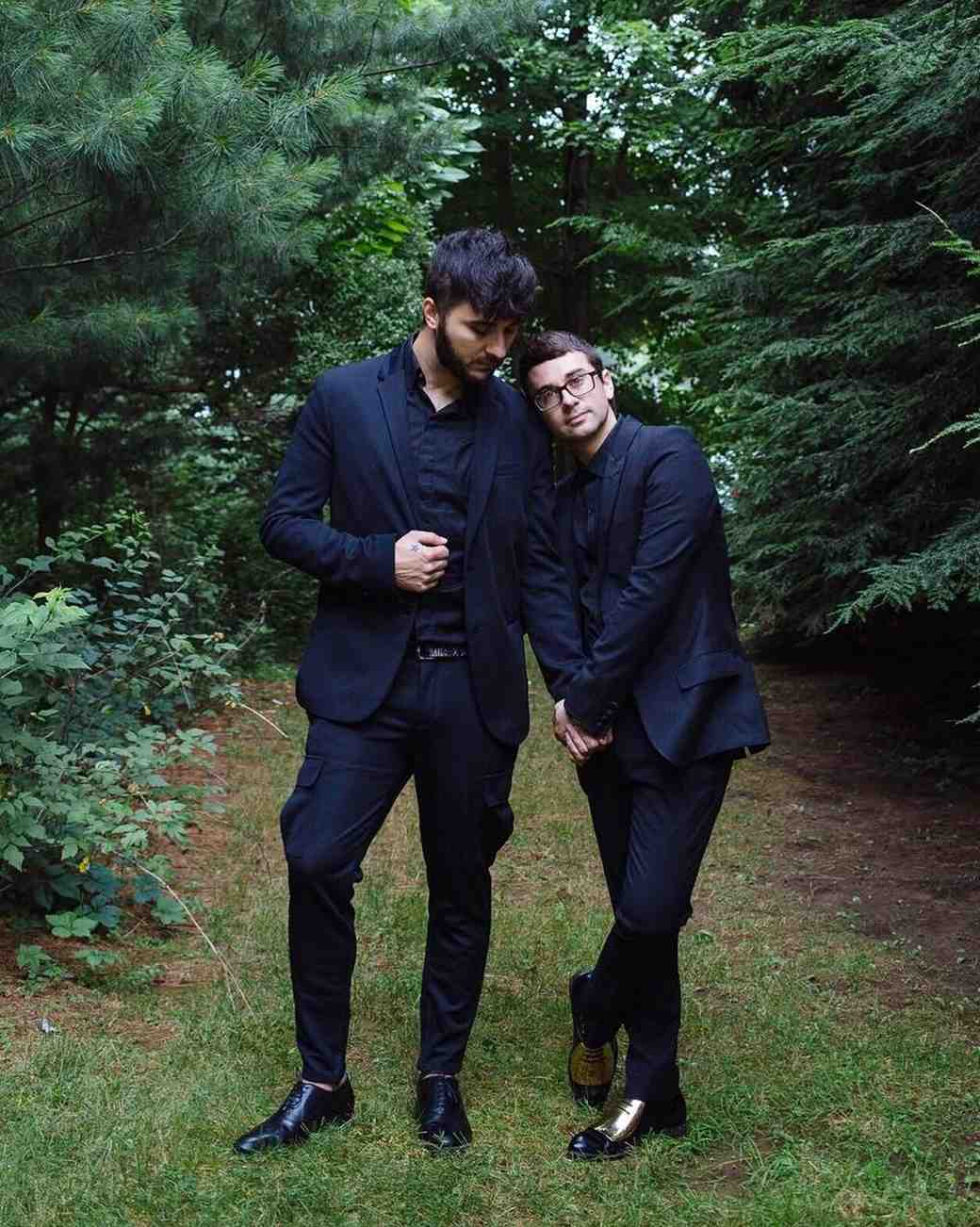 Fashion designer Christian Siriano and his husband, singer Brad Walsh, on their wedding day, in matching black suits.