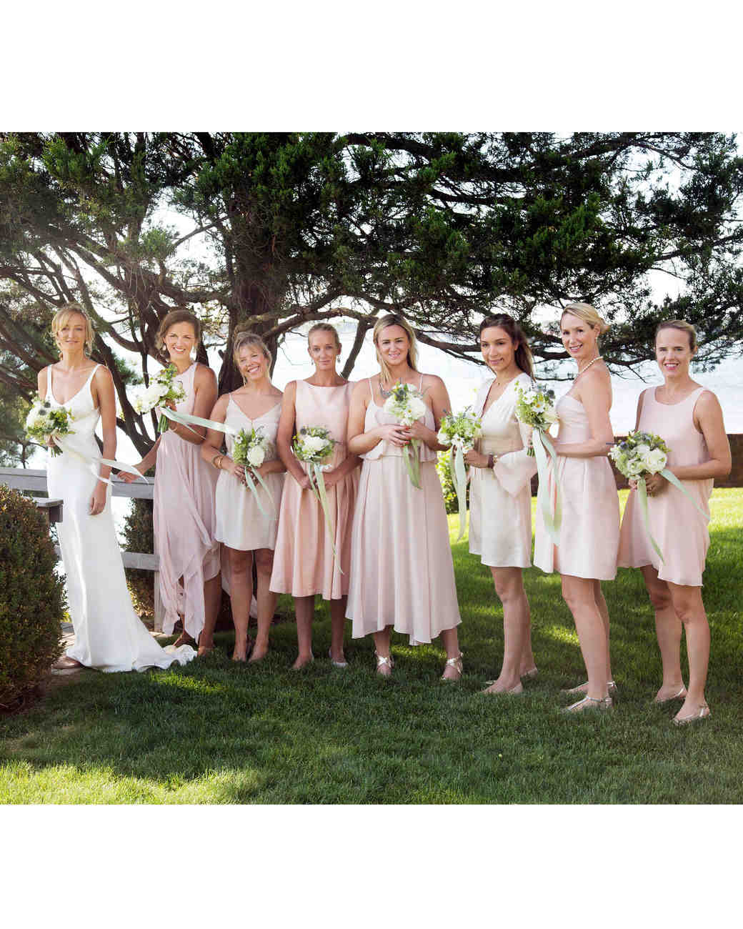 wedding bridesmaids with bride pink dresses