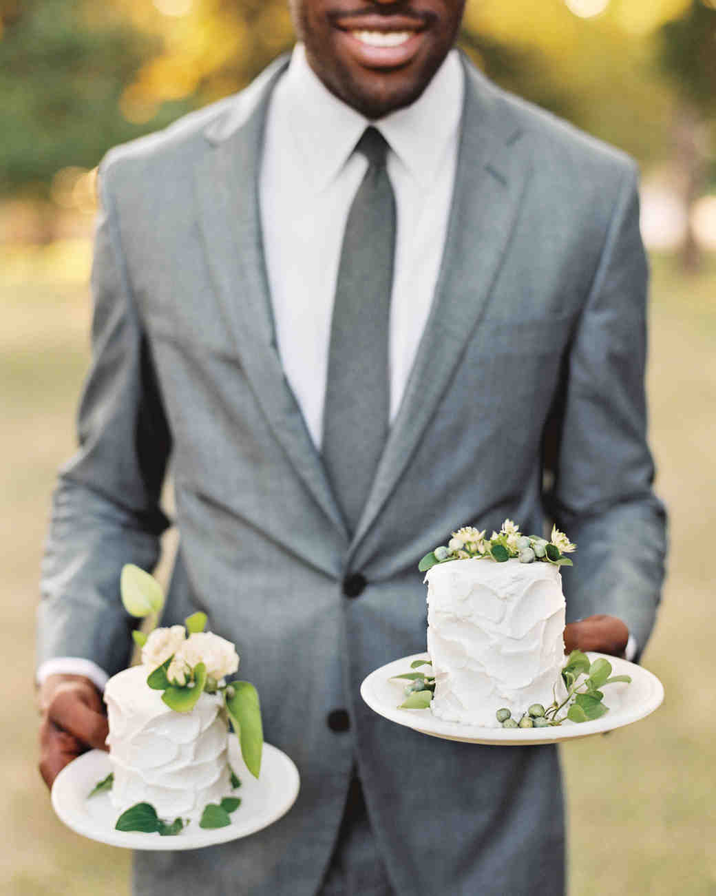 Individual White Wedding Cakes Topped with Greenery