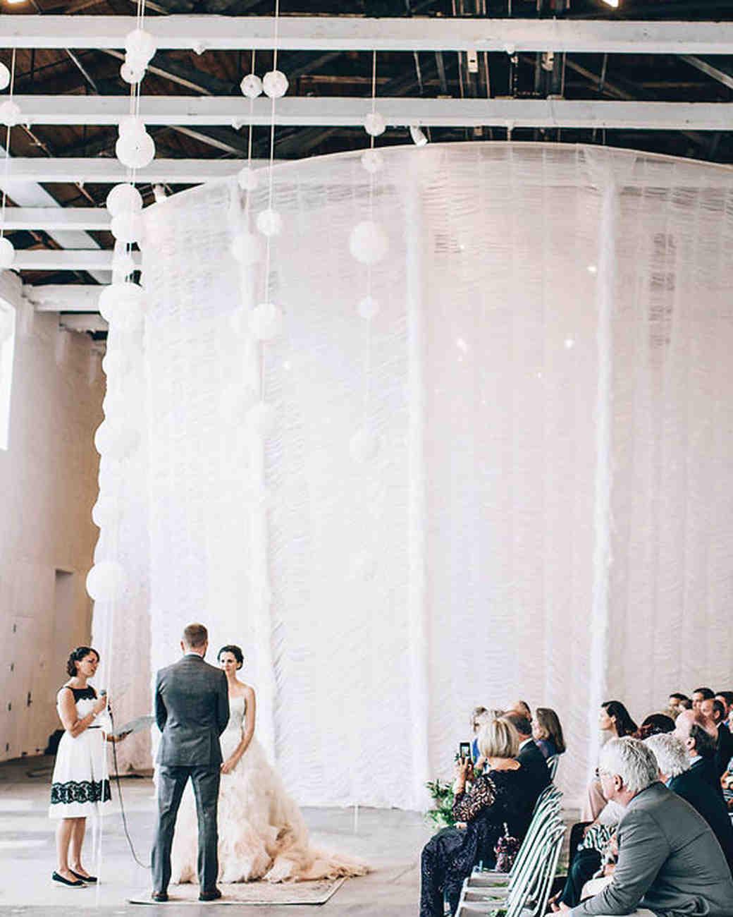 moira-dustin-real-wedding-ceremony-at-the-altar.jpg