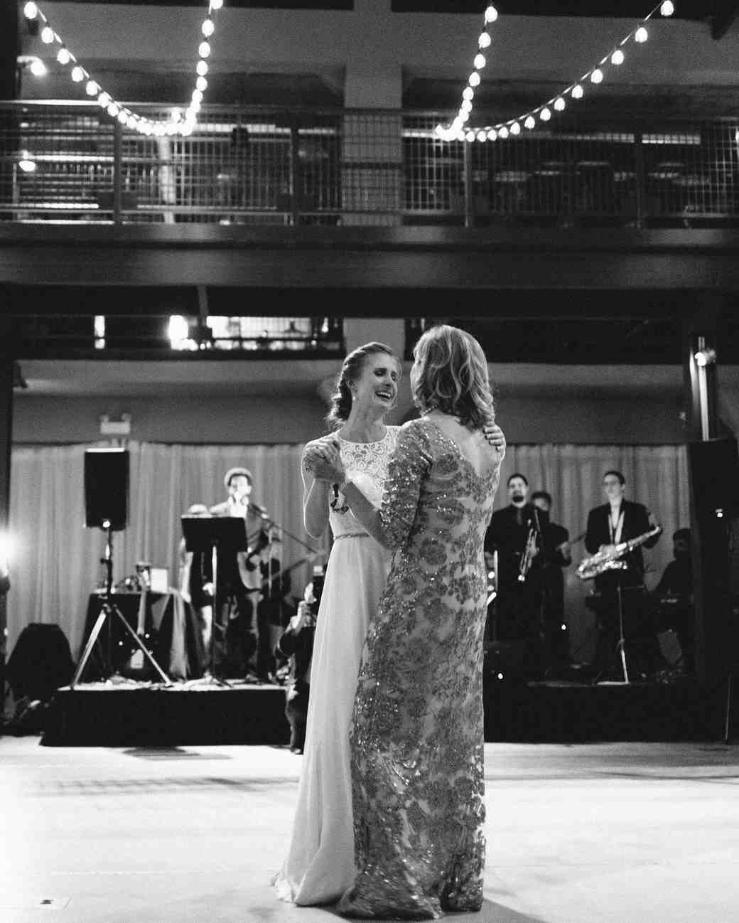 A Bride and Her Mother Dancing at Her Wedding Reception