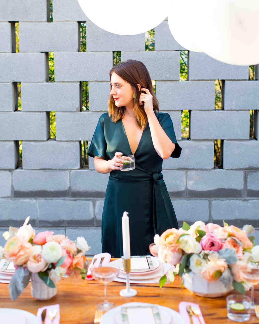 bride standing behind table