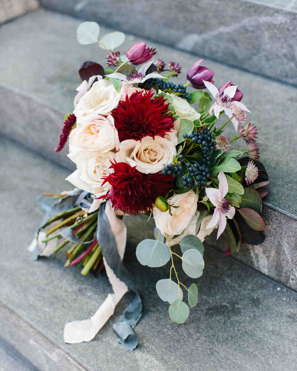Red, Blue, Pink, and Purple Bridal Bouquet on Steps