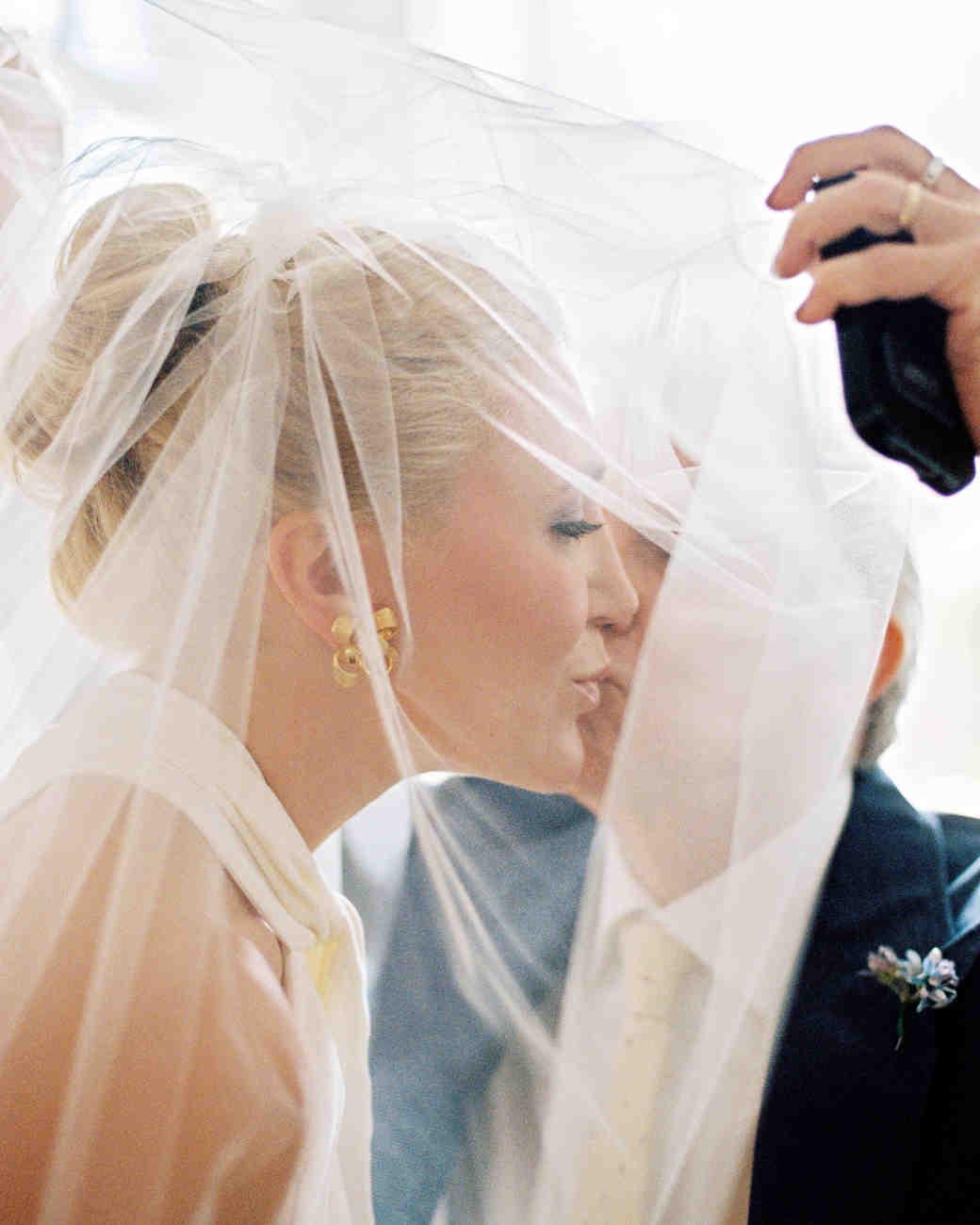 father daughter wedding lifting veil cheek kiss