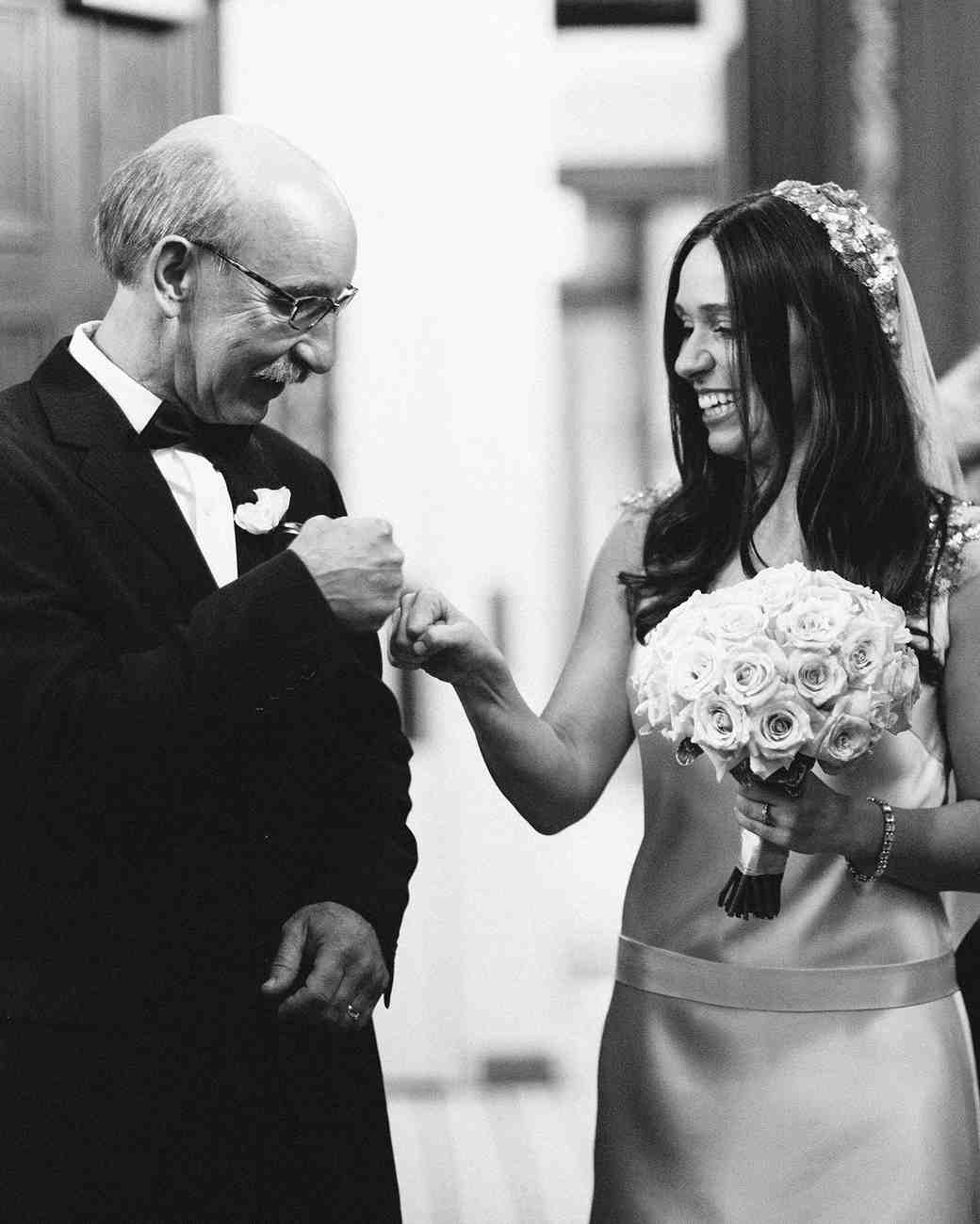 bride and father fist bump
