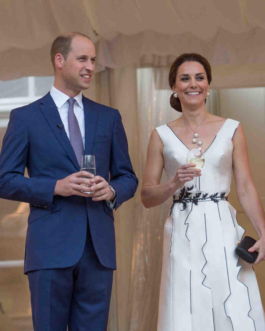 Duchess Kate in a white Gosia Baczynska dress with Prince William