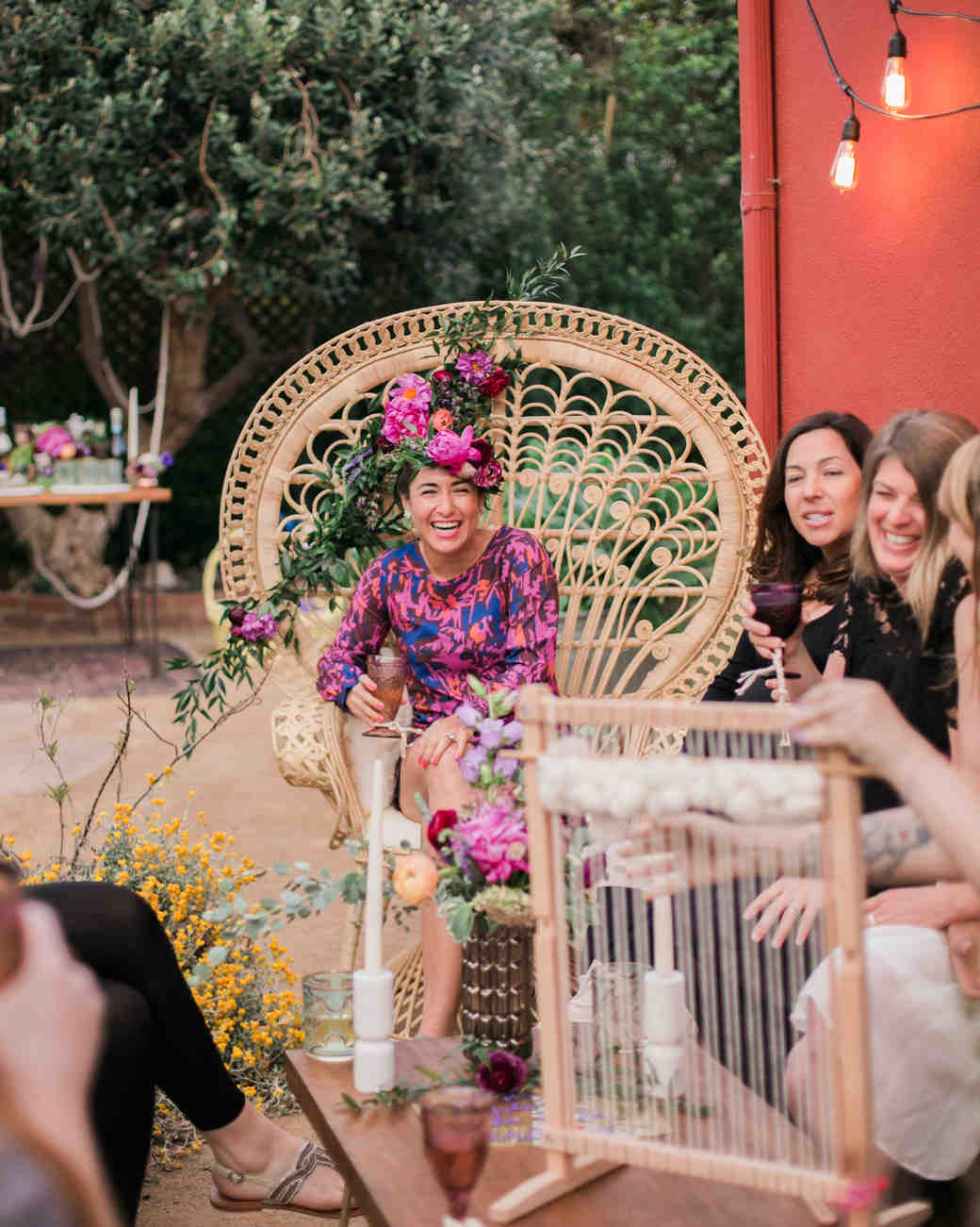 Guests at this boho-chic bachelorette party laugh and mingle while playing games