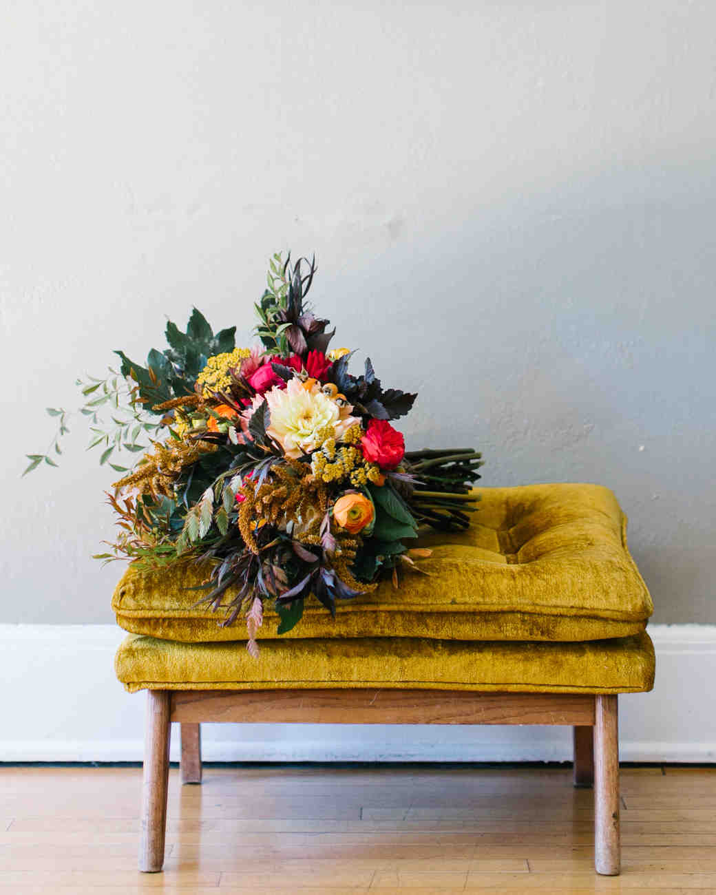 Fall Bridal Bouquet on Yellow Cushioned Stool