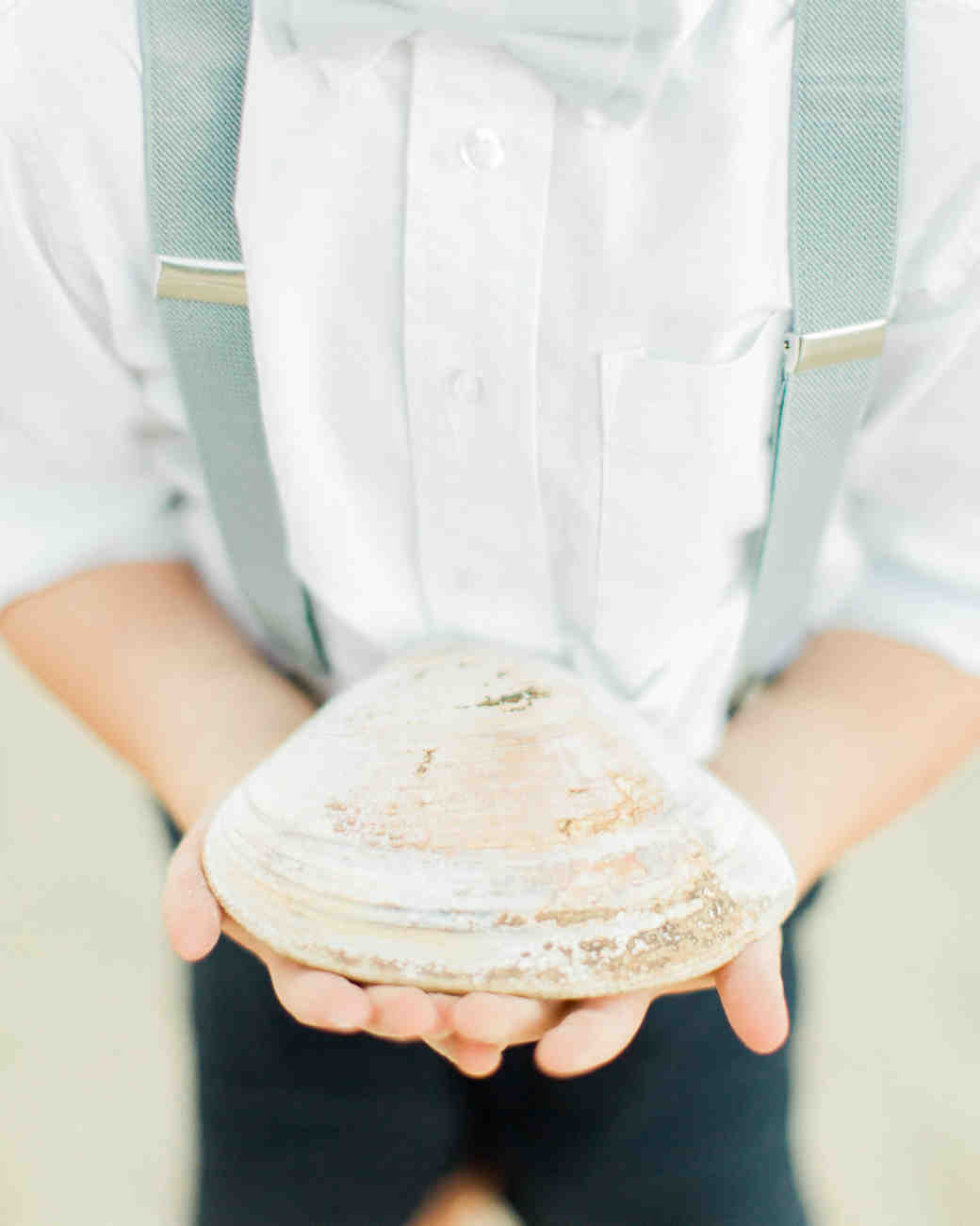 Ring Bearer Holding a Shell