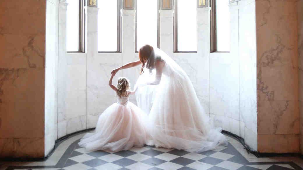 A Bride and Flower Girl Dancing