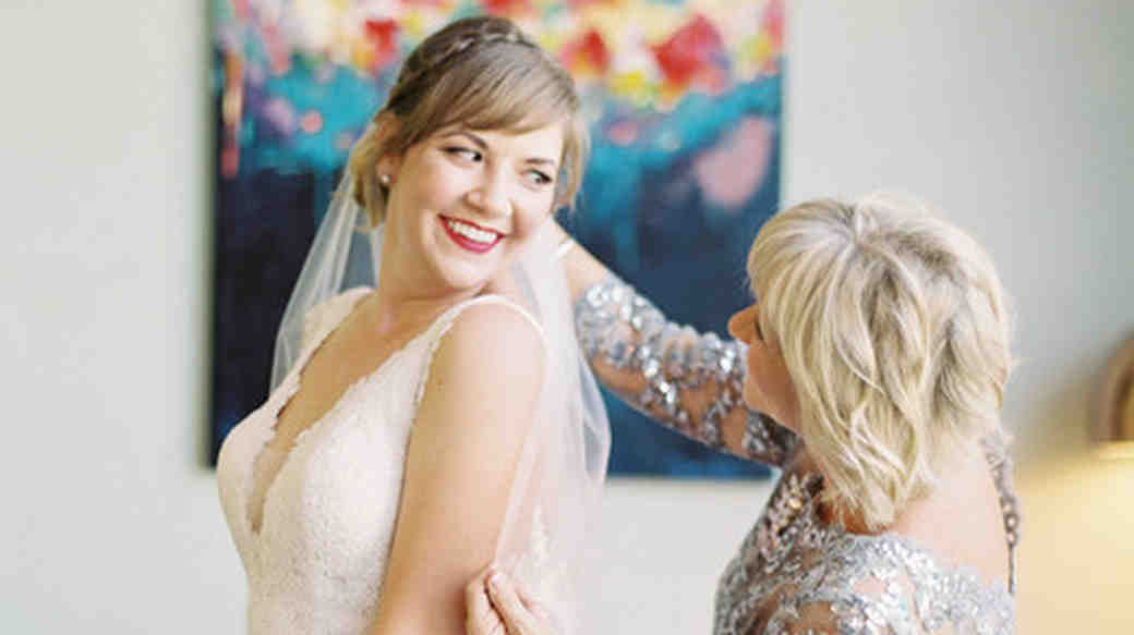 A Mother Helping Her Daughter Put On Her Wedding Veil