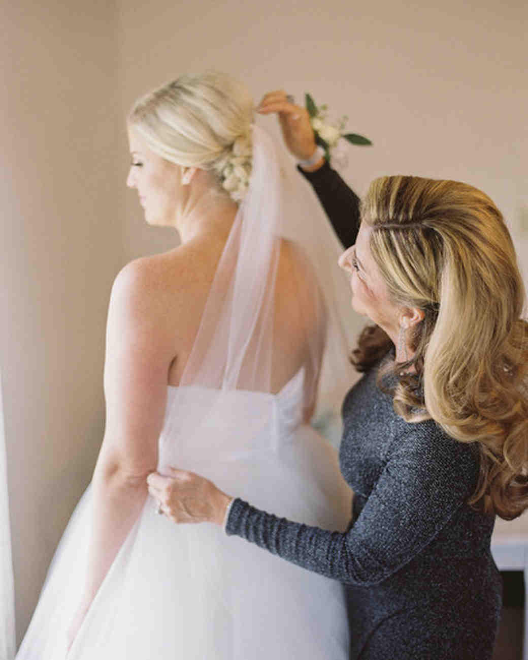 A Mother Helping Her Daughter with Her Hair Before Her Wedding