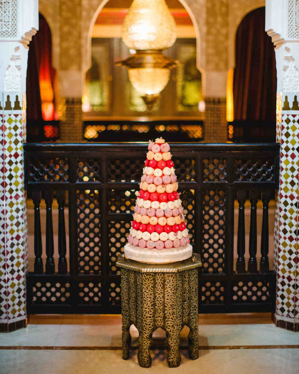 colorful wedding cake with macarons