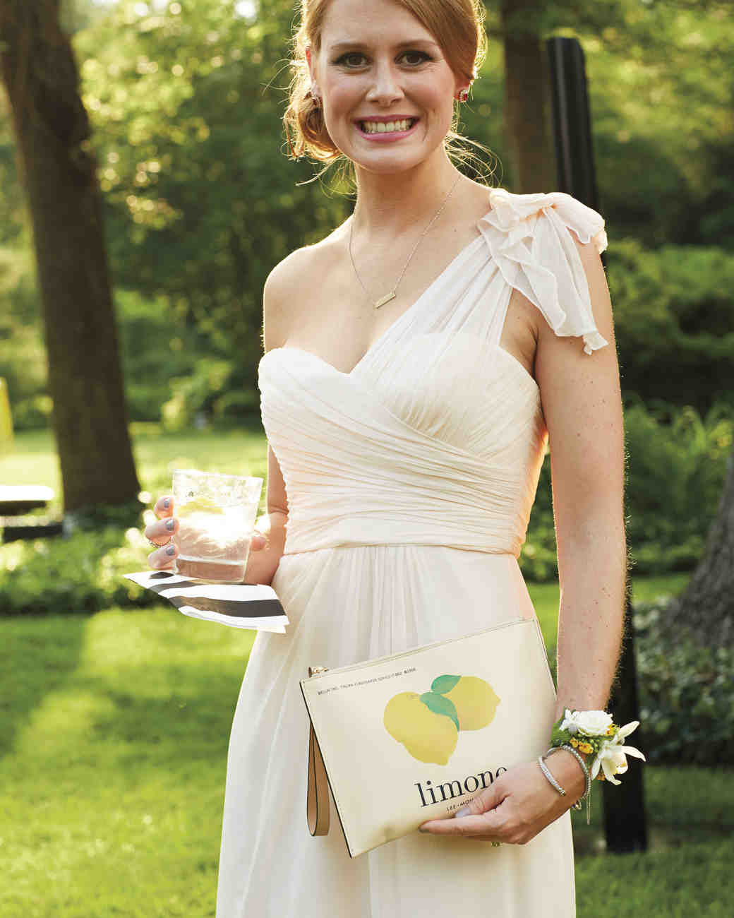 guest holding lemon clutch