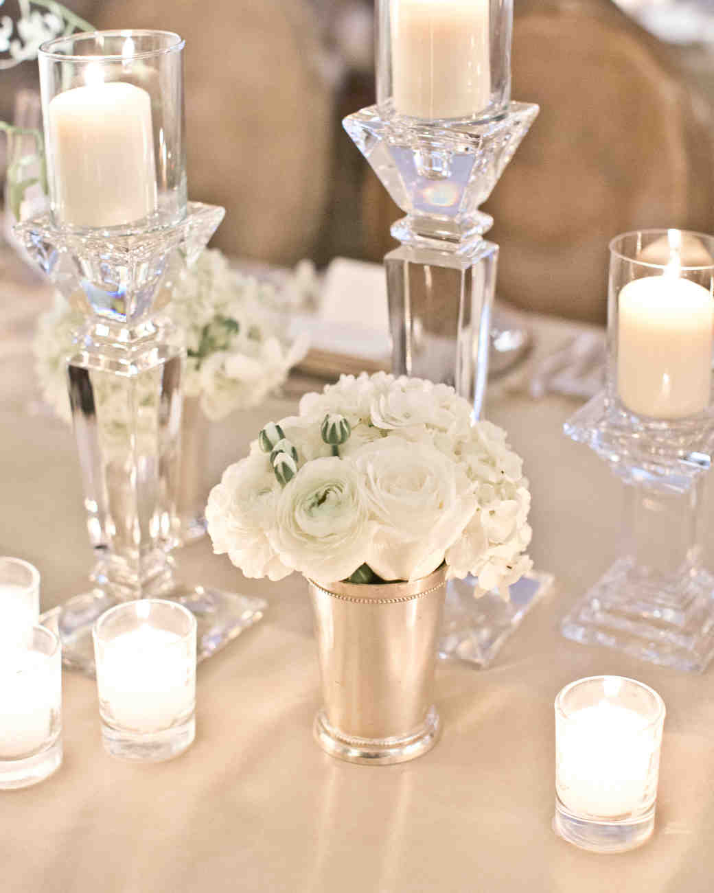 Crystal Candleholders and White Flower Arrangement Centerpiece