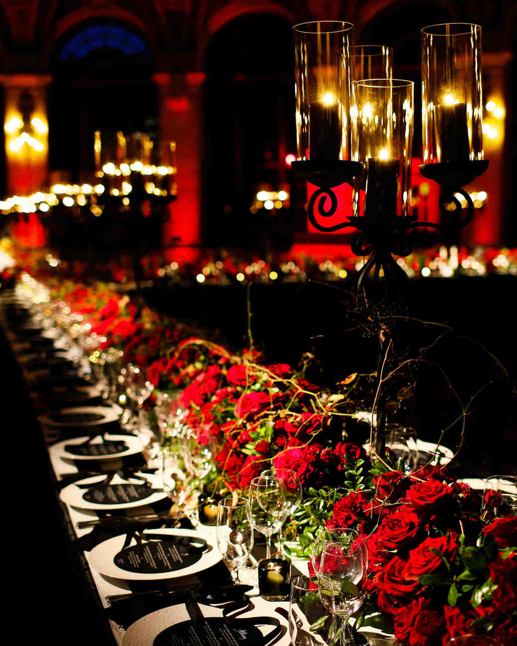 A Table Setup of a Dark Wedding Venue