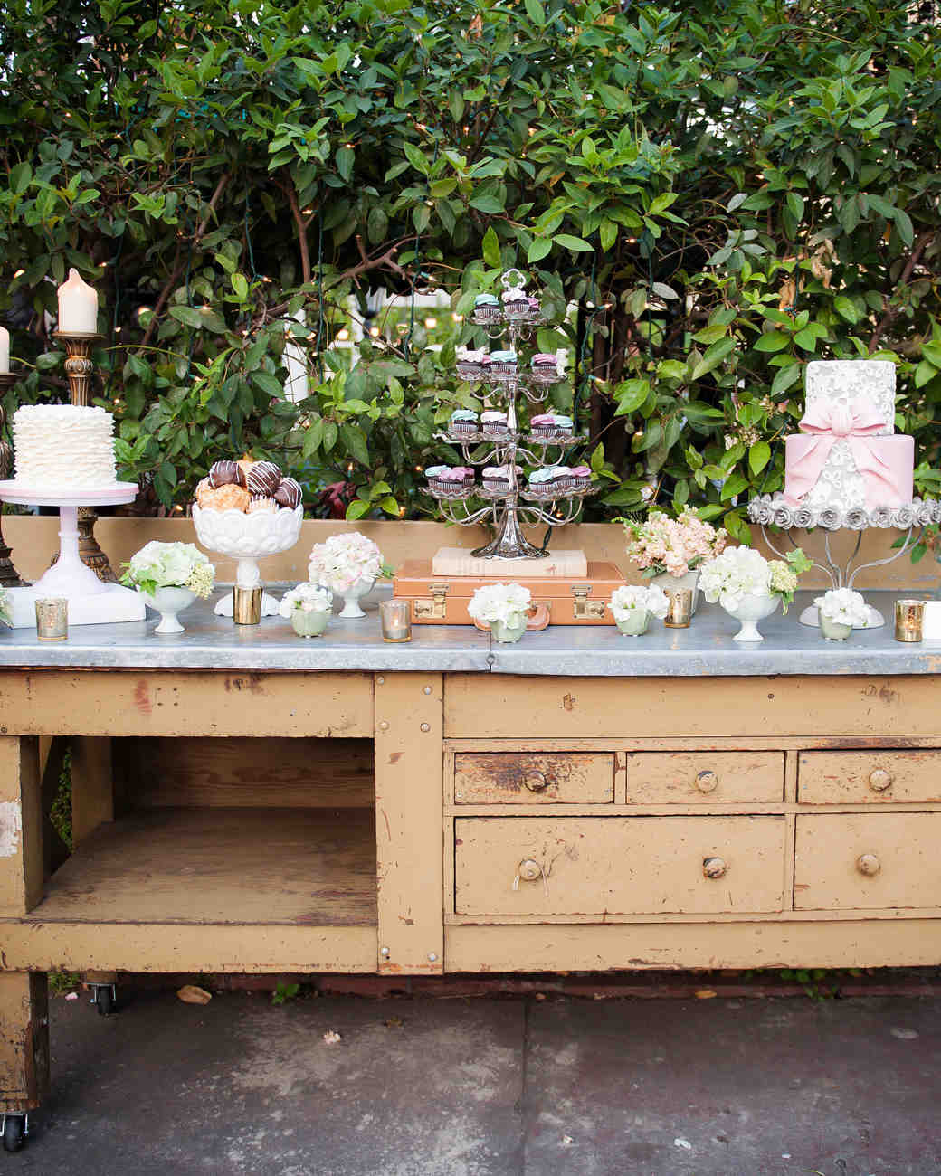 Flowers and Desserts on a Vintage Wooden Table