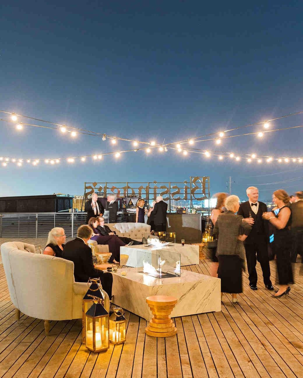 wedding cocktails rooftop string lights