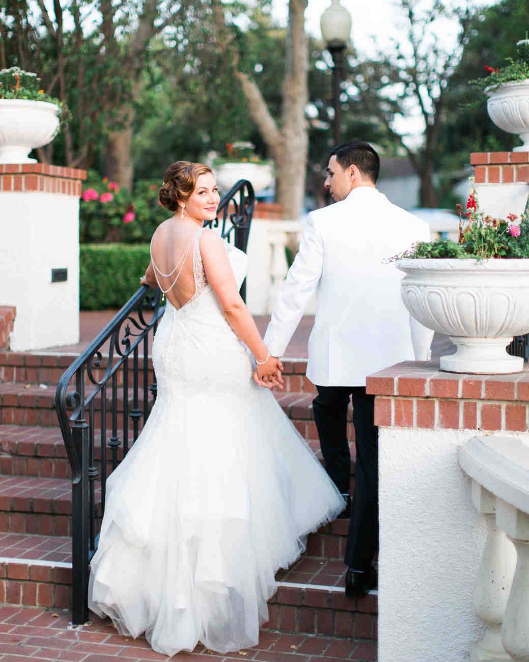 A Bride and Groom Walking Up the Stairs