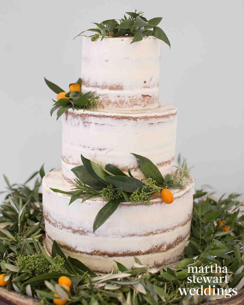 Nearly Naked Wedding Cake with Greenery and Kumquats