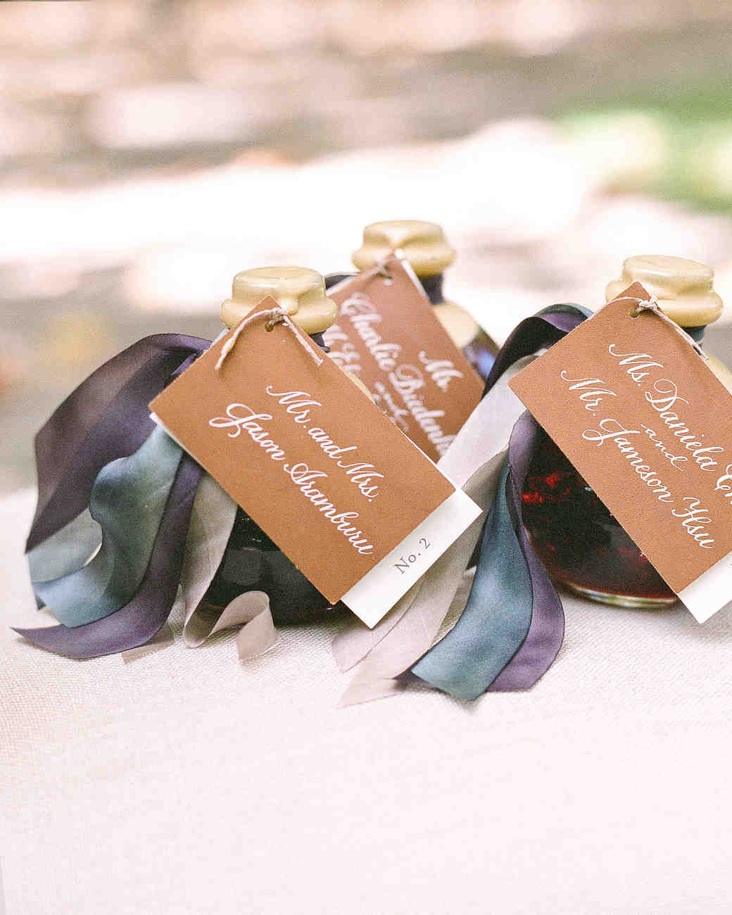 Negronis Bottles With Leather Tags and Blue Ribbon